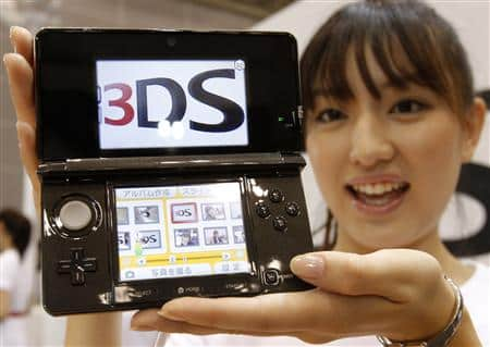 Model poses with Nintendo Co Ltd's new 3DS handheld game console in Chiba